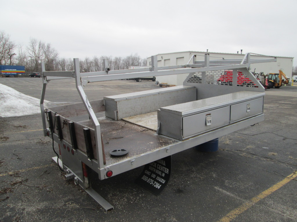 12' Flat Bed w/ladder Rack and tool boxes